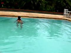 tatooed tgirl ebony plays with a good sized pool shemeat