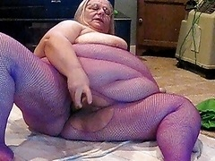 on cam in purple body stocking
