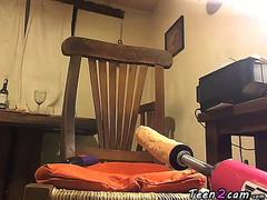 brunette masturbates with a vibrator and a machine while smoking a cigarette video