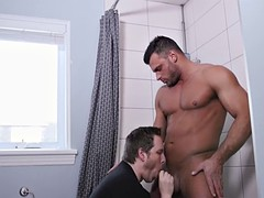 freaky dude gives a blowjob to his new muscular roommate