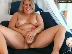 chubby blonde whore fucks herself with a huge dildo