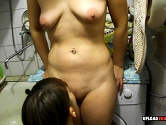 Horny lesbian couple has a quick oral session