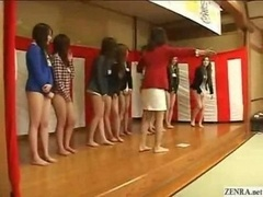 Unique female Japanese employees partake in a bizarre welcoming ceremony that requires them to particiate nude from the waist down