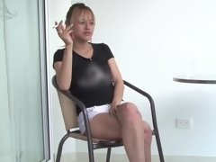 A slim babe that has a cigarette in her mouth smokes a cock