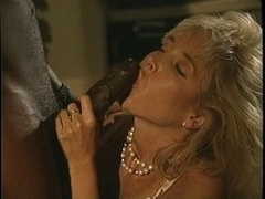 A aroused mature blonde whore rides a stiff black dick of steel