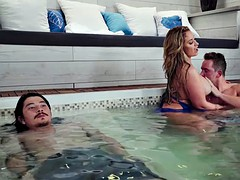 Sneaky MILF fucks young dude in the hot tub