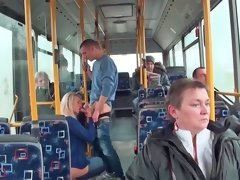 Anal sex is happening in the bus next to some people