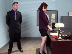 A redhead that has a hairy pussy is getting fucked in the office