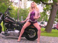 Amazing blonde babe loves her new bike