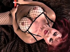 Busty Mommy With Fishnet Suit In Solo Action