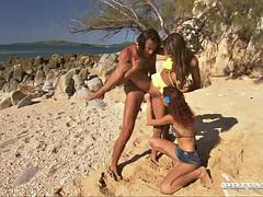 threesome under the hot sun on a nice sandy beach