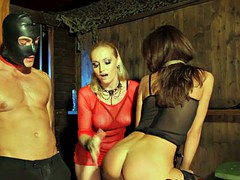 Blindfolded couple dominated by dominatrix