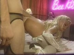 Stacy Valentine bangs in back of the club