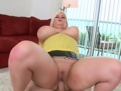 A massive rack goes back and forth as the chick does it doggy style