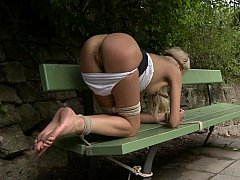 Euro beauty gets tied to a park bench and fucked