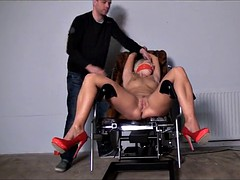 Spanked machine fucked caged