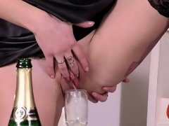 Sultry girl is geeting pissed on and bursts wet vulva