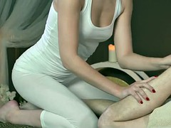 oiledup masseuse rubs cock with feet and tits
