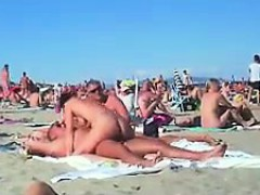 cuckolding in a topless beach gets recorded