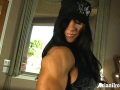 Beefy Milf shows us her muscles then her big clit