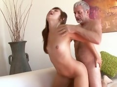 A hot slut with small tits is with a much older dude, sucking dick