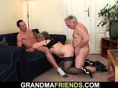 Old granny takes two cocks from both sides