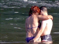 amateur couple frolicking at beach - Madeira Island - Seixal