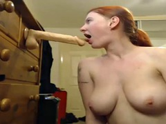 camgirl goes all the way down on a huge dildo