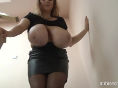 Curvy blonde mature Abbi exposes her monster jugs
